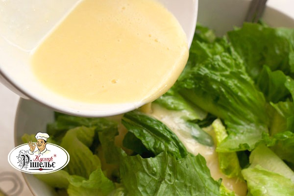 Lettuce leaves under the specialty Caesar sauce